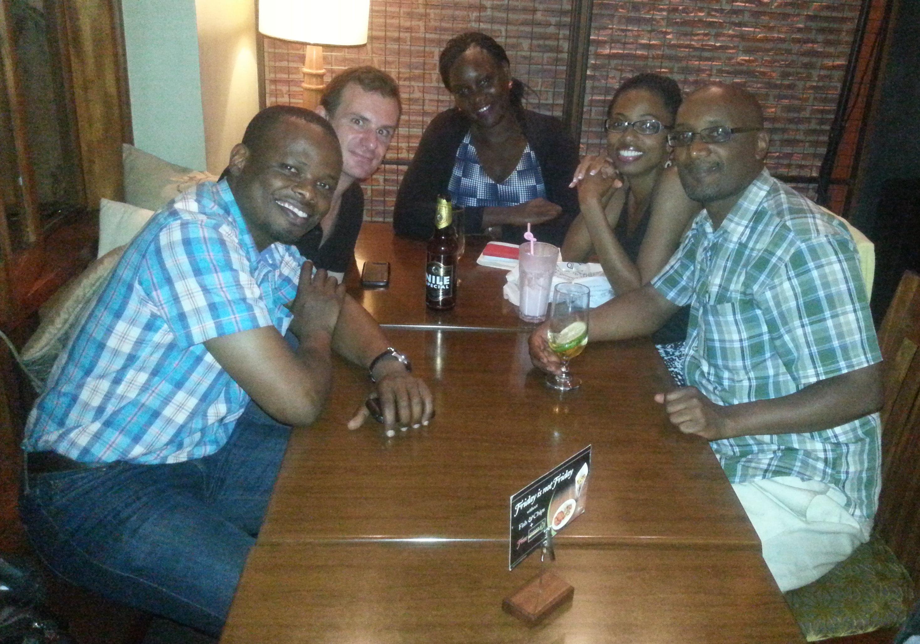 Trainees sharing dinner in Uganda